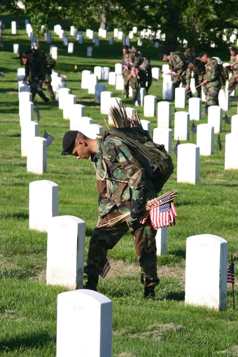 They had a process, place foot against marker, push flag in against heel. Arlington National Cemetery, 5/26/05