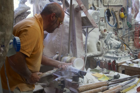 Artisan working alabaster into a bowl Volterra, Italy, 9/11/13